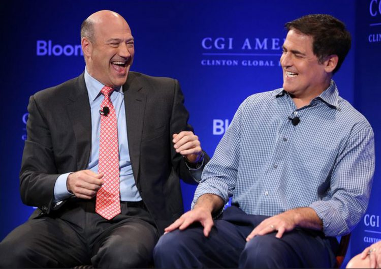 photo of Gary Cohn, president and chief operating officer of Goldman Sachs Group Inc., left, shares a laugh with entrepreneur Mark Cuban during a panel discussion at the Clinton Global Initiative CGI America meeting in Chicago, Illinois. Makeup by Fine Makeup Art & Associates