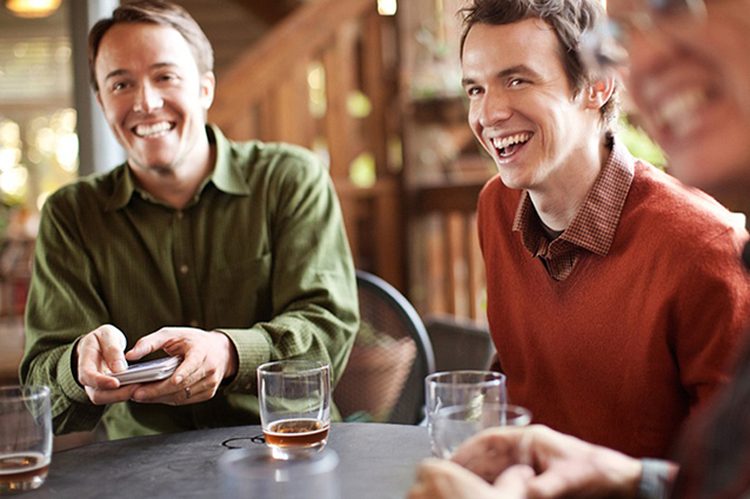 Men in an advertisement for Whiskey